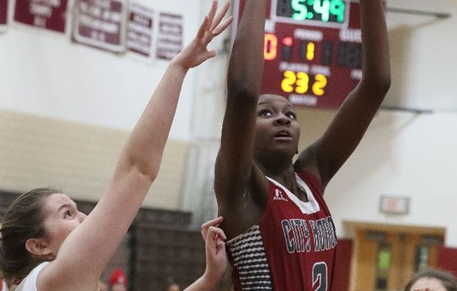 City Honors' Kyra Wood scores over North Tonawanda's Paige Book in the first half of their game. (James P. McCoy, The Buffalo News)