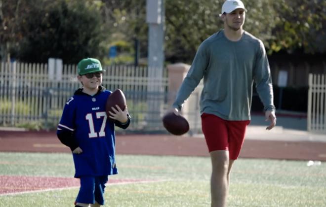 "Bills quarterback Josh Allen spends time with ""Super Cade."" (ESPN)"