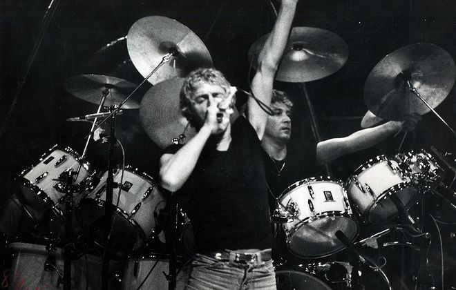 Roger Daltrey, in a black T-shirt, on stage in Buffalo with The Who on Dec. 4, 1979, only a day after 11 spectators died in Cincinnati. (Ronald Colleran/News file photo)