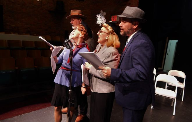 """Les Bailey, Margo Davis, Betsy Ross Visciano and Jason Mussachio star in """"It's a Wonderful Life (Live Radio Play)"""" presented by the Carriage House Players at the Taylor Theater."""