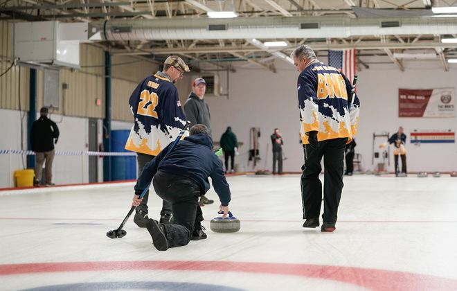 Sweepers melt the ice to reduce the friction of the moving stone, aiding speed and aim. Each one weighs 44 pounds. (Dave Jarosz)