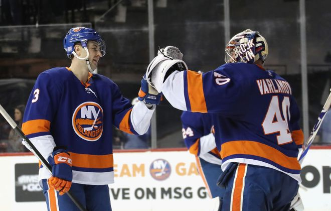 Islanders defenseman Adam Pelech (3) and goalie Semyon Varlamov  celebrate a 2-0 shutout of Columbus Nov. 30 in Barclays Center (Getty Images).