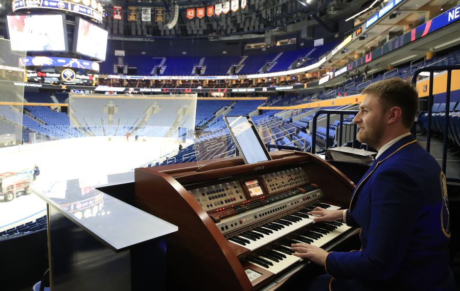"""Sabres in-game organist Curtis Cook said, """"I love hearing people's stories on how they connect a memory with a certain piece of music."""" (Harry Scull Jr./Buffalo News)"""