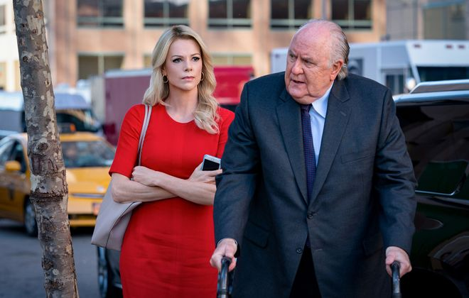 """Charlize Theron, left, as Megyn Kelly, and John Lithgow as Roger Ailes in """"Bombshell."""" (Hilary Bronwyn Gayle/Lionsgate)"""