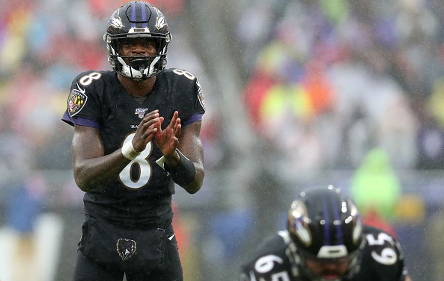 BALTIMORE, MARYLAND - DECEMBER 01: Quarterback Lamar Jackson #8 of the Baltimore Ravens takes a snap against the San Francisco 49ers defense at M&T Bank Stadium on December 01, 2019 in Baltimore, Maryland. (Photo by Rob Carr/Getty Images)