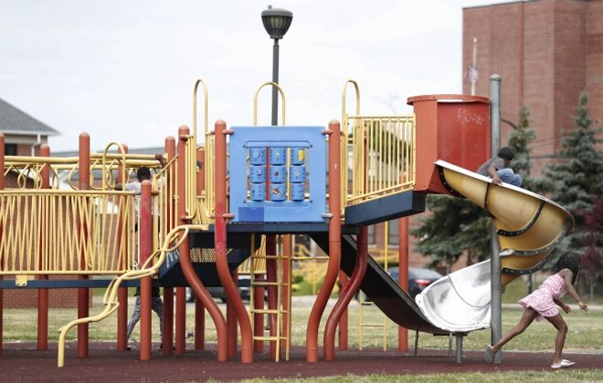 Hot metal slides and missing swings at the Kenfield Homes playground, revealed in a Buffalo News investigation, were just one example of the inequitable conditions some children in Buffalo Niagara grow up in. (Sharon Cantillon/News file photo)