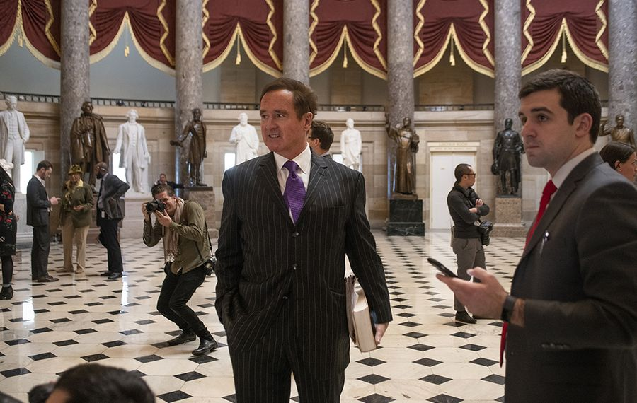 Rep. Brian Higgins prepares for a television interview in Statuary Hall outside of impeachment proceedings in the House Chamber on Wednesday morning. (Stephen Crowley/Special to The News)