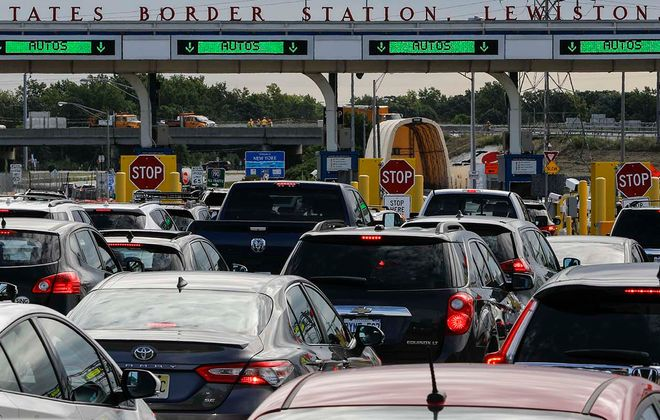 Vehicles arriving in the United States wait for customs at the Lewiston-Queenston Bridge, Thursday, Aug. 22, 2019. (Derek Gee/Buffalo News)