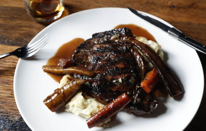 Toutant was awarded 10 plates for dishes like the ribeye, which is nearly a pound of meat charred over applewood smoke and brushed with bourbon butter. (Sharon Cantillon/Buffalo News)