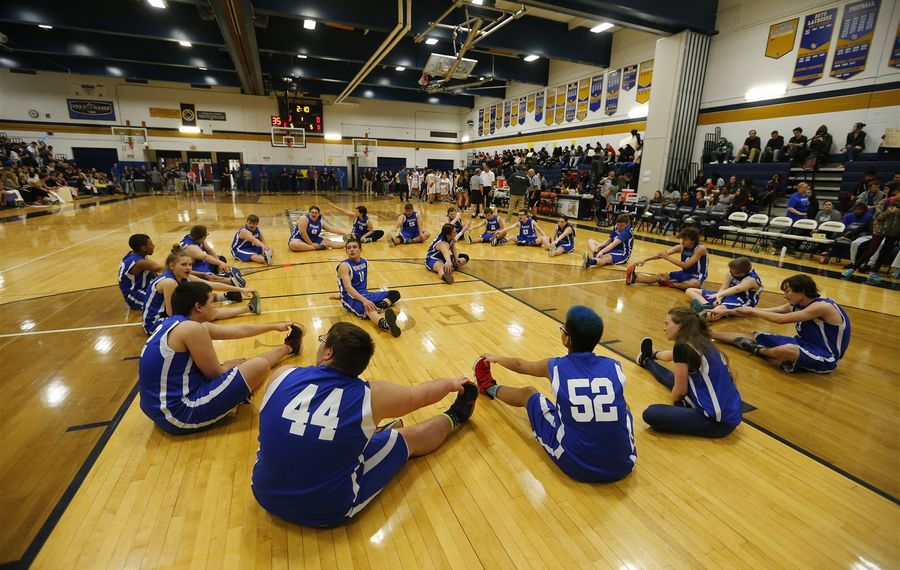 The Newfane High School unified basketball team warms up before a game at Sweet Home. (Mark Mulville/Buffalo News)