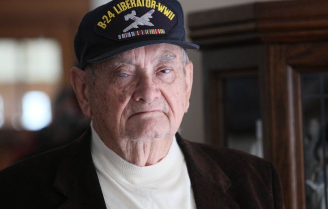 Robert J. Seitz flew missions in WWII. He was at his home in Amherst on Dec. 13, 2010. (Robert Kirkham/Buffalo News)