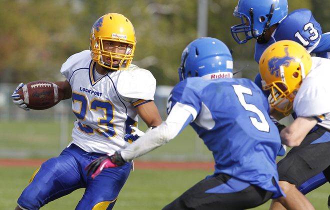 Harry Scull Jr. / Buffalo News    James Chambers caught the go-ahead score in Lockport's win over Kenmore West.