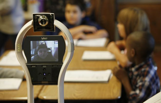Devon Carrow, 7, participates in class at Winchester Elementary School from home using VGo robot.  Derek Gee/Buffalo News