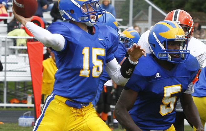 John Hickey / Buffalo News    Cleveland Hill and quarterback Jacob Radlich improved to 4-0 with a 16-13 victory over Wilson.
