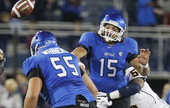 Mark Mulville / Buffalo News    UB quarterback Alex Zordich is hit by Kent State's Roosevelt Nix on a throw in the first half of the 23-7 loss Wednesday.