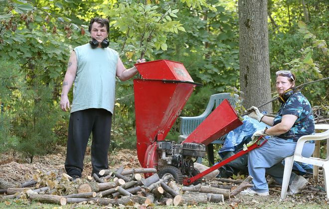 Robert Kirkham/Buffalo News  Denise Woods and her husband, Bill, are fighting with the Town of Hamburg over the use of their wood chipper, which she uses to create mulch for her expansive garden.