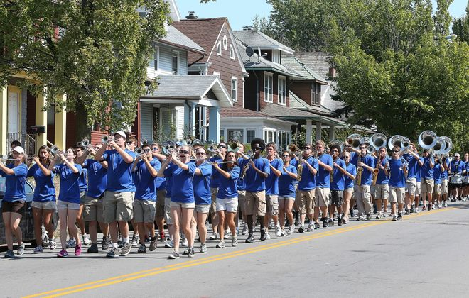 John Hickey/Buffalo News    The University at Buffalo marching band makes its way down Winspear Avenue toward Main Street on Sunday during a block party that brought together students and community members.