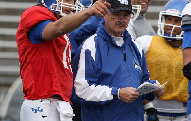James P. McCoy / Buffalo News    Alex Zordich talks things over with quarterback coach Don Patterson during practice Wednesday afternoon at UB.