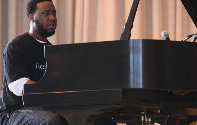 Robert Glasper, on the piano, performs at Art of Jazz in the Albright-Knox. (News file photo)