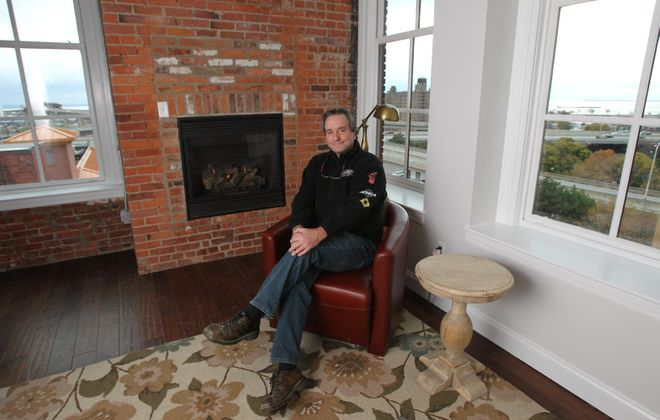 Earl Ketry, owner of the Lofts on Pearl, in one of the hotel rooms that used to be a loft apartment.