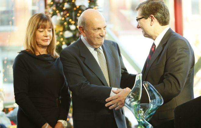 Kaleida Health CEO James R. Kaskie, right, thanks Sal H. Alfiero and his wife, Jeanie, for a $5 million donation to Women & Children's Hospital at a ceremony Thursday.