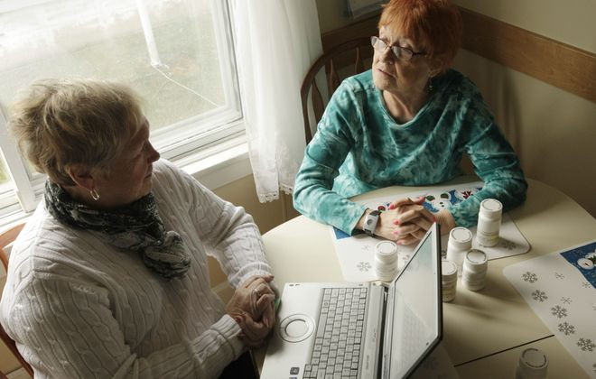 Peggy Lalley, a nurse, visits  Lillian Cretacci at home after her release from Mercy Hospital to make sure her medications were in order and that a follow-up doctor appointment was scheduled.