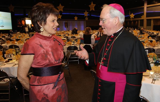 Maureen Orth, widow of Tim Russert and keynote speaker at the 2013 Catholic Education Dinner, chats with recently installed Bishop Richard J. Malone before festivities began at Statler City.
