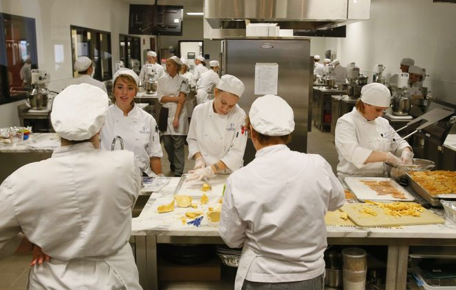Students work in the pastry lab at the new Niagara Falls Culinary Institute, which has revived a portion of the long-vacant Rainbow Mall downtown.