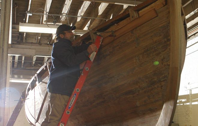 { for local story }  Kevin McCarthy, Trustee of the Friends of the Edward M. Cotter. works on a replica  of the USS Trippe, War of 1812 Armed Cutter, Saturday, Feb. 2, 2013. He's putting a cedar bender on the hull.  It is being constructed at The Buffalo Maritime Center in Riverside.  They hope to finish for the bicentennial celebration  of the Battle of Lake Erie in Sandusky Ohio in September.  The Friends of the Edward M. Cotter own the boat.   {Sharon Cantillon / Buffalo News}