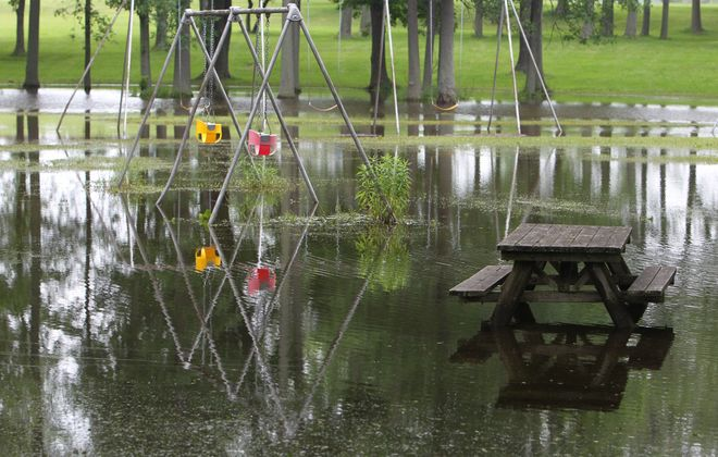 A picnic area near the marina at Beaver Island Park  sits under several inches of rainwater Monday.