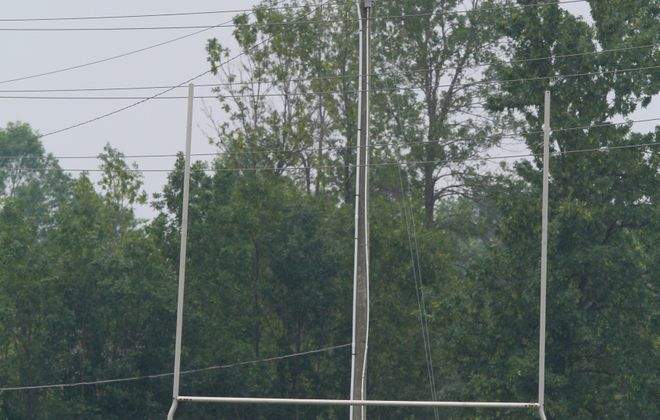 Crews respond to the athletic fields at Lancaster High School after four people were hurt when a goal post hit an overhead electrical wire Monday.