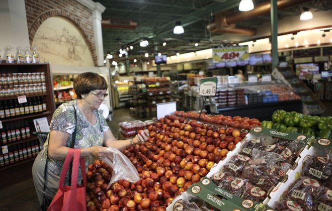 Betsy Bandelian picks out some nectarines at Dash's Market produce section on Wednesday, July 10, 2013.  (Matthew Masin/Buffalo News)