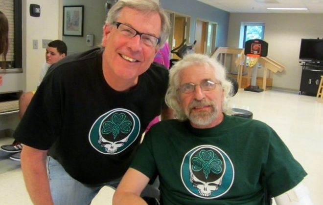 Bob McDonald, left, visits his friend, Bill Sheehan, in Craig Hospital in Denver, where Sheehan is rehabilitating after a devastating car accident in April. Friends are organizing a fundraiser for Sheehan, a former teacher, for next Sunday.
