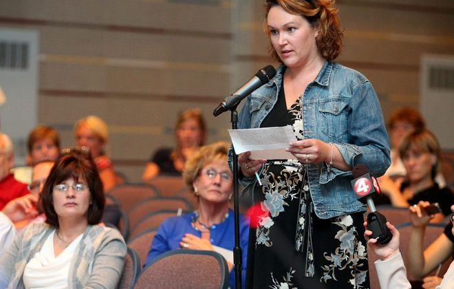 Heather Kopera addresses Ken-Ton School Board at a special work session on district consolidation in Kenmore East High auditorium. Concerns persisted on scenarios offered in consultant's report.