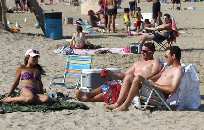 Huong Dao, Nate Costello and Tom Teeeto came over from Canada to enjoy the beach and water at Woodlawn Beach in Hamburg, on Tuesday.