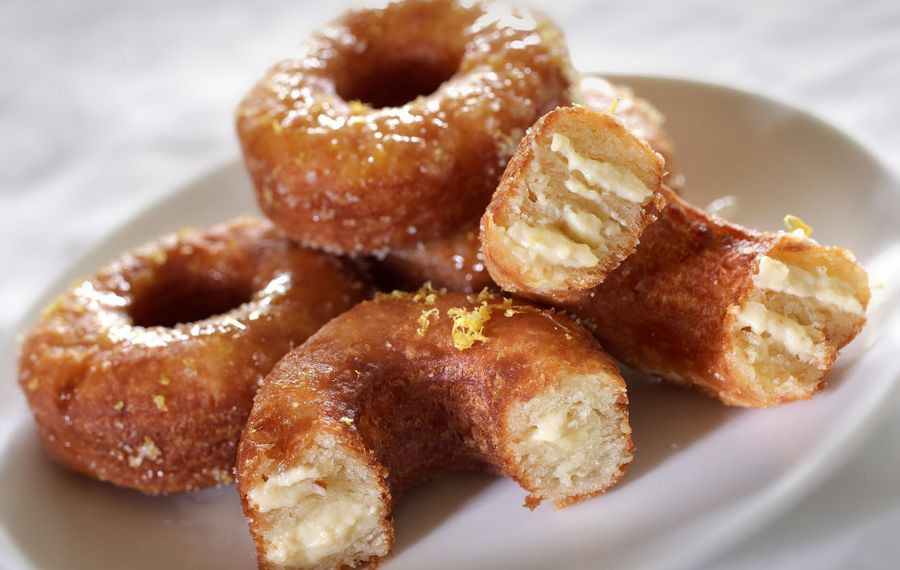 Cronuts are made with croissant dough, plumped with pastry cream and then glazed.