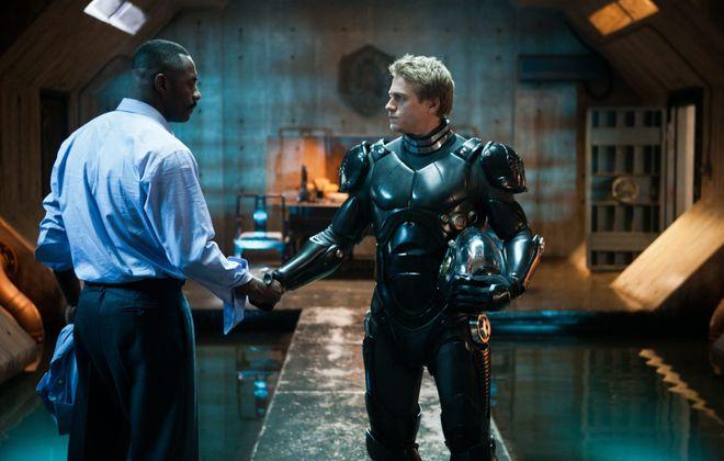 "Idris Elba, left, and Charlie Hunnam star in ""Pacific Rim."""