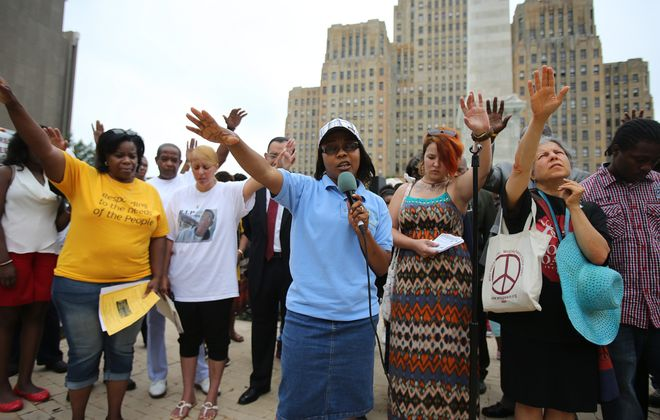 Paulette Hayles, of Buffalo, center, speaks during Tuesday's interfaith prayer rally – organized by the Stop the Violence Coalition and several other groups – in Buffalo's Niagara Square.