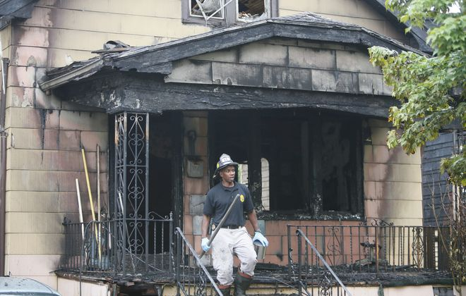 Buffalo fire marshals collect evidence at 367 Riverside Ave., where an early morning fire claimed the life of an infant Tuesday.