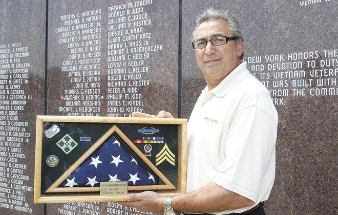 Richard DiChristina, a Vietnam War veteran, stands at the Vietnam memorial at the Naval and Military Park.