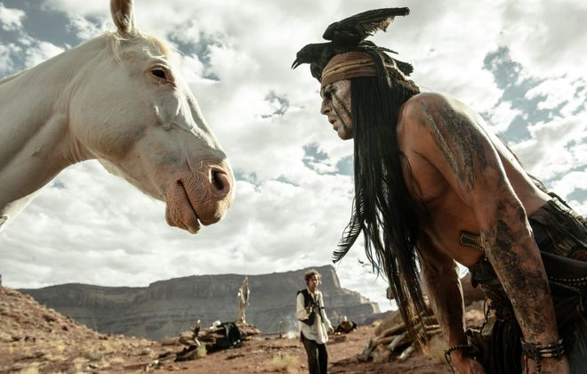 """Tonto, played by Johnny Depp, shares a moment with Tonto in """"The Lone Ranger."""""""