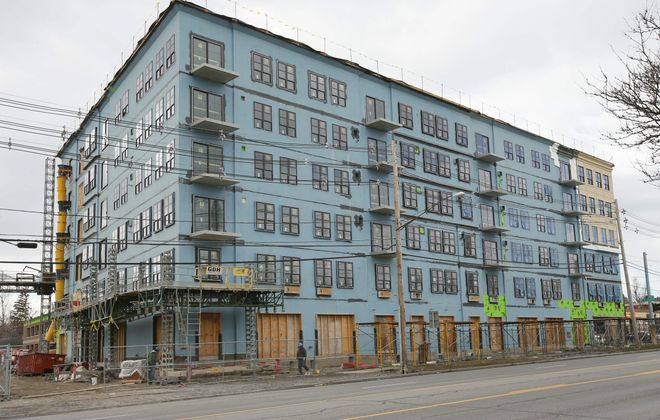 Ellicott Development nears completion of $35 million building at Main Street and South Forest Road housing a 120-room hotel, retail, restaurant and apartments.