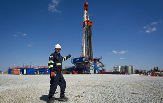 Jeff Boggs of Consol Energy stands in front of a horizontal gas drilling rig exploring the Marcellus Shale outside Waynesburg, Pa. If fracking proves safe, it could help get the nation's economy back on track.