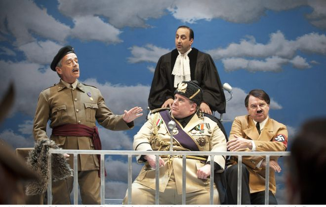 "Lorne Kennedy, left, appears with Sanjay Talwar (standing), Neil Barclay and Ric Reid in the Shaw Festival's production of ""Peace in Our Time: A Comedy."""