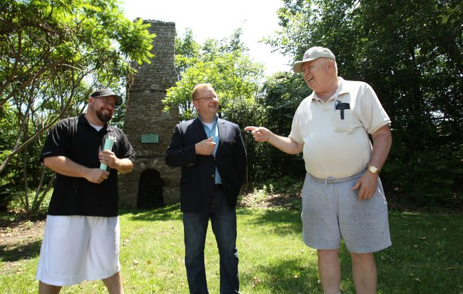 With the Old Stone Chimney as backdrop, three  advocates  – from left, Christopher Stoianoff, Christopher Puchalski  and Paul Gromosiak – discuss how it fits into Falls' future.