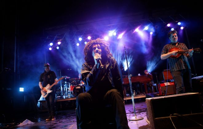 Counting Crows performs on a rainy night Friday during a Buffalo Place Rocks Canalside concert. Another photo on Picture Page, C10; see a photo gallery at BuffaloNews.com.