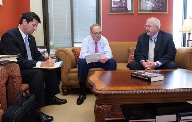 From left,  Erie County Executive Mark Poloncarz  meets with Sen. Charles E. Schumer and FEMA Administrator W. Craig Fugate to discuss costs of the 2006 October surprise storm.