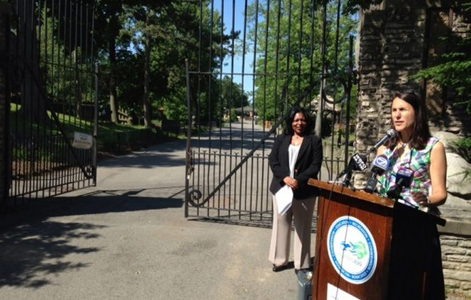 Buffalo Zoo president and CEO Donna Fernandez, right, and Karen Stanley Fleming, chairwoman of the Michigan Street African American Heritage Corridor Commission, announce Friday that the Buffalo Zoo's entrance Gates 3 and 4, designed by John E. Brent, Buffalo's first black architect, were added to the National Register of Historic Places.