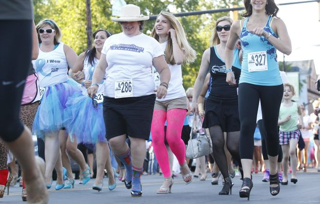 Runners and walkers take part in the sixth annual Stiletto Run, hosted by the ShoeFlyn shoe store, Wednesday on Elmwood Avenue. See a photo gallery at BuffaloNews.com