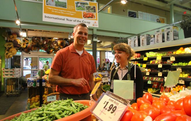 General Manager Tim Bartlett chats with member Michelle Sallander at Lexington Food Co-op.